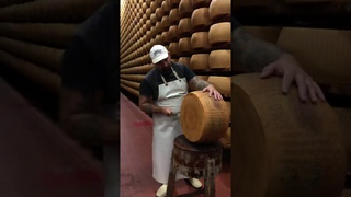 They use a small hammer to hear if the Parmigiano-Reggiano is ready.