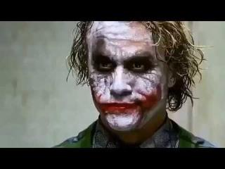 Joker shows Batman a meme